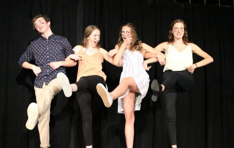 Sophomore Jack Yampolsky, junior Isabelle Knowles, senior Megan Yarnall, and senior Carter Warner perform during Improv's Sept. 13 performance, the troupe's first of the year.