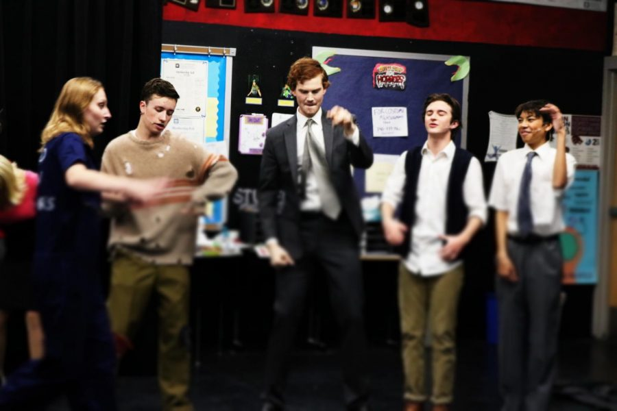 Sam Roberts leads the energizers on the DMHS Little Shop of Horrors premire on Wednesday, the 23rd of November, 2019.