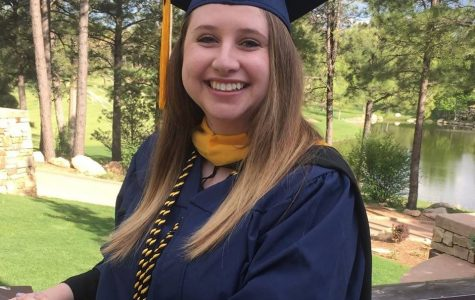 She's a Lumberjack and she's OK: Ms. Onofry celebrates her masters degree in psychology from Northern Arizona University.